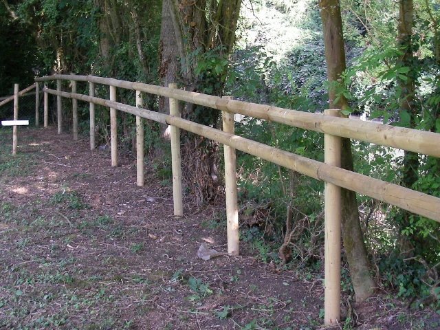 Repaired timber fence